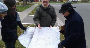 Peterborough. Residents pour over map during exploratory walk